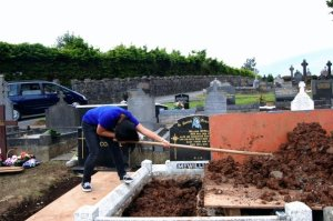 Filling a grave in Armagh.
